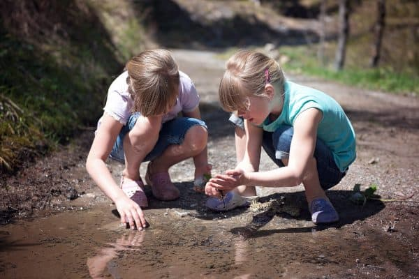 Children Playing with Tadpoles